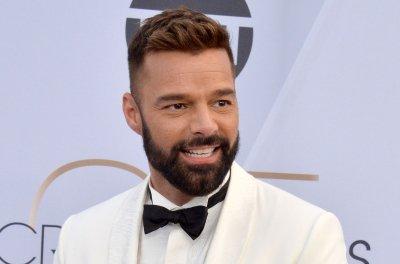 Ricky Martin, Jwan Yosef introduce son Renn