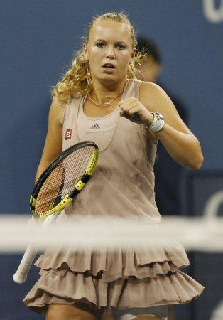 Wozniacki takes three-set win in Japan