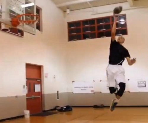 NBA slam champ LaVine challenges Beckham Jr. in dunk tape