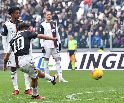 Paulo Dybala snaps in bending free kick in Juventus win