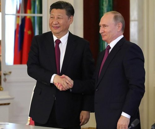 Putin says energy is a priority for Russian, Chinese relations
