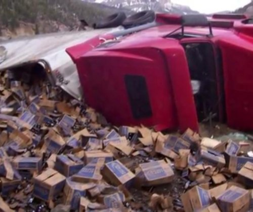 Runaway truck loses 41,000 pounds of beer on highway ramp