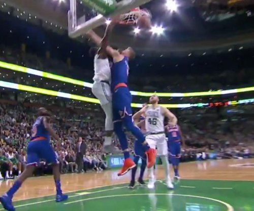 Celtics' Jaylen Brown throws down dunk on Kristaps Porzingis