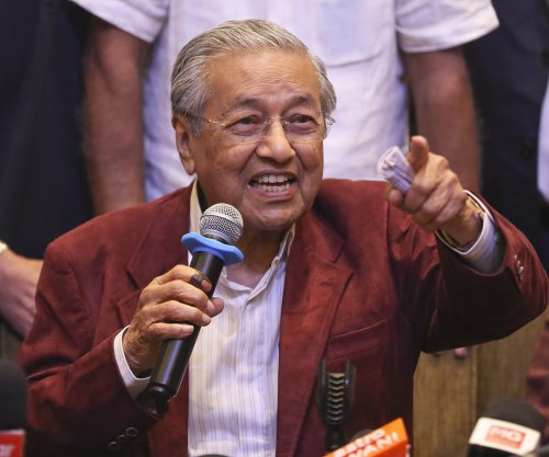 Malaysian opposition party declares victory for first time in 6 decades