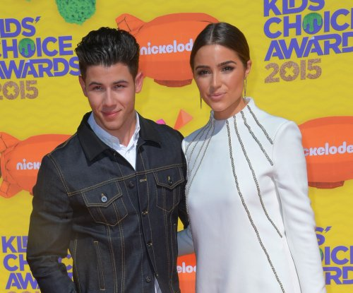 Olivia Culpo supports beau Nick Jonas at Kids' Choice Awards