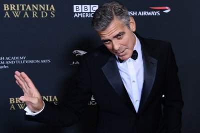 George Clooney uses past roles as online pseudonyms, leaves voicemails as 'Batman'