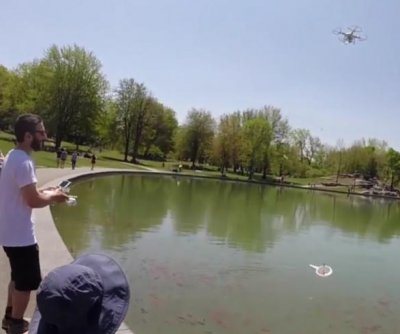 Drone used to grab goldfish out of public pond