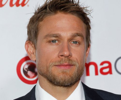 Charlie Hunnam says his King Arthur is a 'reluctant hero'
