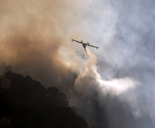 Officials want more planes to fight wildfires in southeast France