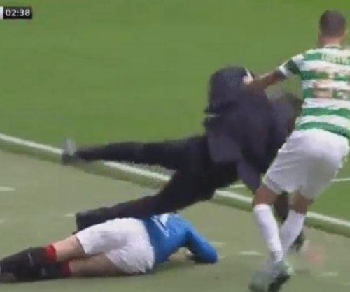 Rangers' Josh Windass slide tackles manager in game vs. Celtic
