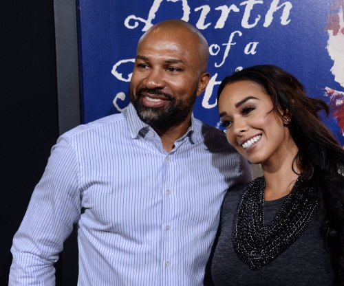 Former Los Angeles Laker Derek Fisher suspected of DUI after car flips in crash