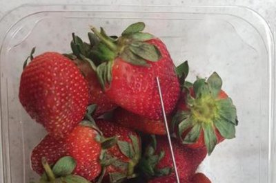 Australian police arrest boy for hiding needles in strawberries