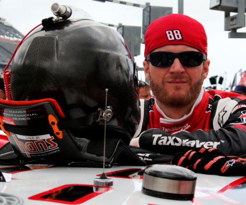 Earnhardt Jr. holds off teammate Johnson at Talladega