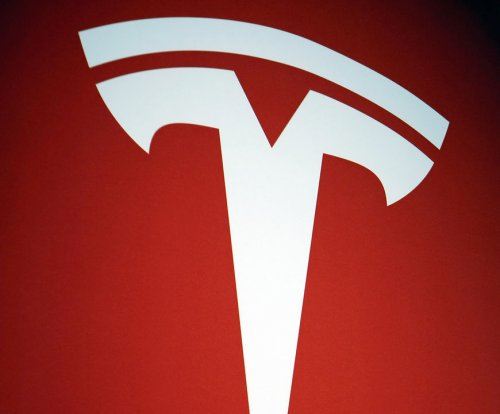 Tesla posts nearly $300 million loss in second quarter