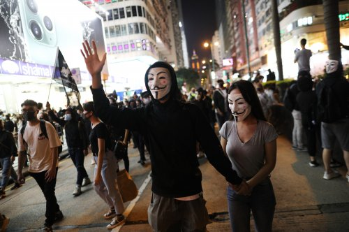 Hong Kong court rules face mask ban unconstitutional