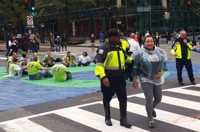 Photos: Walmart workers arrested in New York and Washington protesting for $15 minimum wage