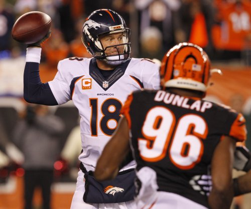 Visor on head, Denver Broncos' Peyton Manning gets day off