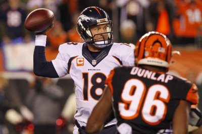 Visor on head, Denver Broncos' Peyton Manning gets day off
