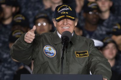 Trump touts 'peace through strength' aboard Navy's new $13B supercarrier