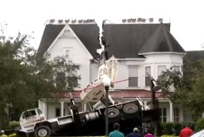 Watch:-Crane-falls-on-roof-of-house-in-Florida