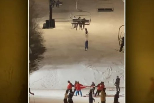 WATCH:Skier dangling from chairlift uninjured after being caught in tarp