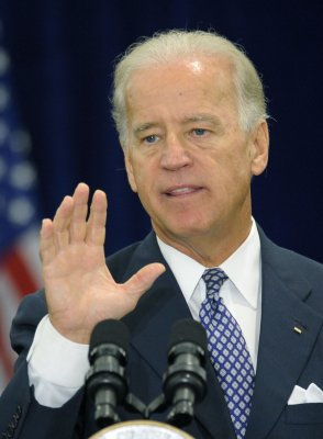 Biden defends Obama's busy slate