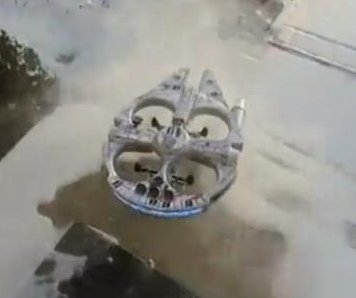 Custom Millennium Falcon drone clears snow from front walk