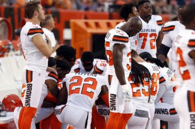 Cleveland Browns players kneel during national anthem prior to playing New York Giants