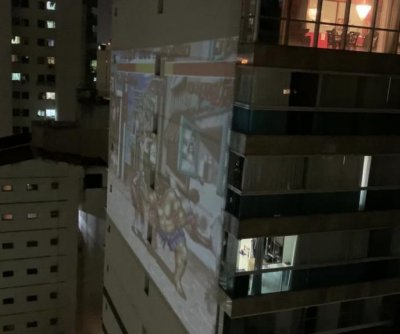 Giant game of 'Street Fighter II' projected onto apartment building