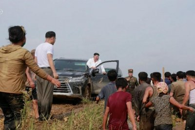 Kim Jong Un takes luxury vehicle to flash-flood zone