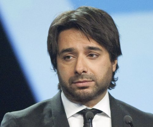 Ex-CBC host Jian Ghomeshi arrested, charged with sexual assault
