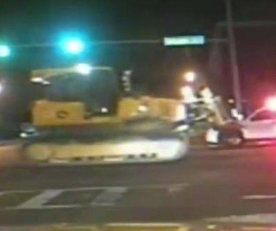 Police release footage of stolen bulldozer crushing patrol car
