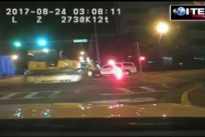 Police release footage of stolen bulldozer crushing patrol car