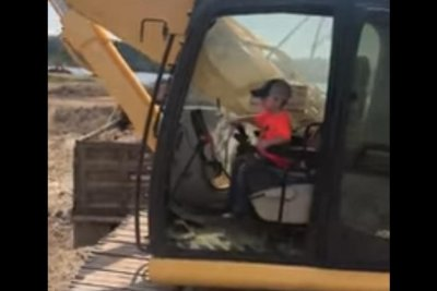 Man lets 5-year-old son operate backhoe solo