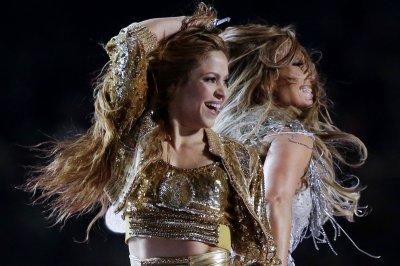 Shakira surfs in 'Don't Wait Up' music video