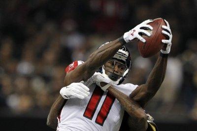 Atlanta Falcons smoke New Orleans Saints, keep playoff hopes alive