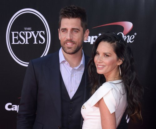 Aaron Rodgers says fame made dating Olivia Munn 'difficult'
