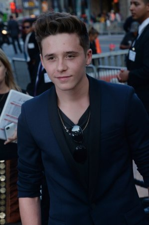 Following father's lead, Brooklyn Beckham signs with Arsenal