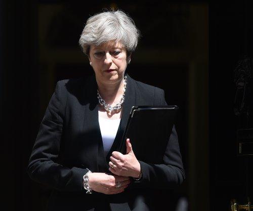 Theresa May condemns 'sickening' attack at London mosque