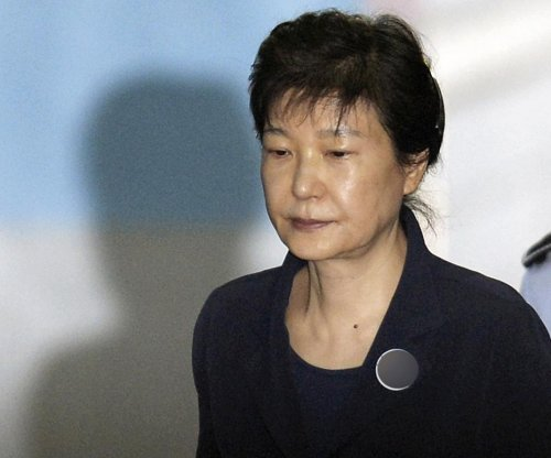 Former South Korea president faints during 8-hour court appearance