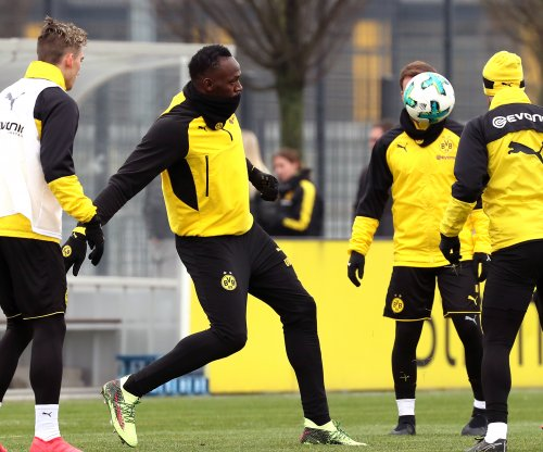 Usain Bolt: Olympics legend scores twice in Dortmund training