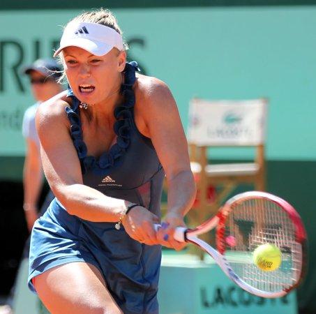 Wozniacki advances on home soil