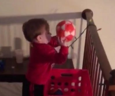 Budding basketball star, 2, shows off balcony trick shot