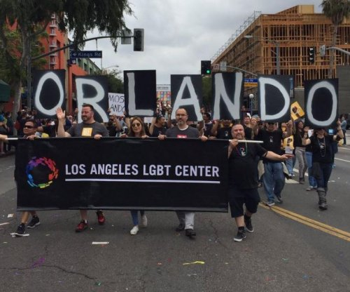 Moments of silence, increased security at gay pride events after Orlando shooting