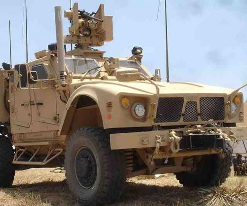 Defense companies demo 30mm chain gun on land vehicle