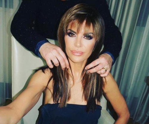Lisa Rinna swaps her signature shag for long hairstyle