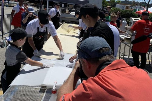 Pizza festival creates 59-foot calzone for Guinness record