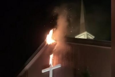Dog's alarm credited with saving New York church after fire erupts
