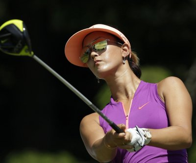 Wie returns to U.S. Women's Open with new swing