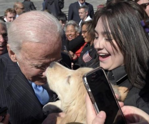 Joe Biden meets golden retriever named Biden